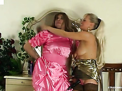 Dressed up sissy guy getting pumped up the arse by a strap-on armed woman
