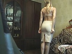 This blonde fem was late so that chick didn't have time to look around or even think that there could be a voyeur with the livecam in her room when that chick put on her white lacy bra and beige petticoat