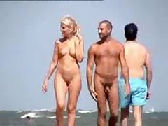Nude couple filmed walking along the beach, nice blonde with cute tits and shaved pussy.