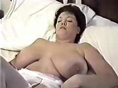 This homemade movie is a mix of sexy movie scenes I have taken of my huge-titted wife. You can watch her strip, give me blowjob, shave her cunt, masturbate during the time that I fuck her, play with sex toys and take a bath.