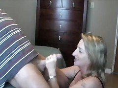 This lady loves to handle and engulf her husband's cock.  This playgirl sucks it, puts on some flavored lube, and the strokes the shaft while this playgirl tonguing the tip in her mouth.  That fellow finally cums in her mouth, moaning, and this playgirl swallows, with just a little bit of the cum dribbling out.