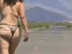 Out in the open desert walking in the middle of a highway with only a g-string covering her large wazoo body. In this public sex video u can see this aged bitch walk naked out in the open and flaunt her large fucking ass.