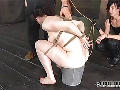 Constipation won't be a problem for Dixon anymore. She tried to do it in a bucket but didn't worked so her headmistress inserts a pantyhose in her oiled arsehole and gives the slut an enema. Some other slut is tied on the wall and watches everything, knowing that she's next. Does Dixon feels humiliated enough or this babe needs more?