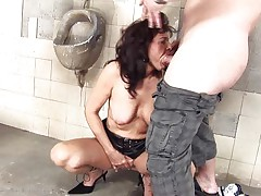 She's a dirty whore and does everything a man asks her. Here she is, in an abandoned public toilet engulfing this chap and then licking his anus before that guy bonks her from behind. She's a cougar that enjoys a good dirty fuck and probably will enjoy his semen too so stick with us and watch this wench in full act