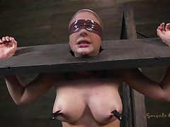 Clamps with weights were attached on her big boobs and duct tape was used to blindfold her. Now she stays there in that thraldom device and has a rodeo sex machine underneath her that's rubbing her shaved pussy. To make things interesting an executor comes and deeply throat bonks this slut girl, chocking her with pecker