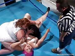 2 breasty midget ladies were fighting on the ring. And their referee was a midget guy. The women were pulling each others hair, tearing clothes. And then out of nowhere, those 2 women pulled off his panties and started engulfing his cock. They did some lesbian move too. Let's see how this FFM went!