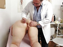 Yvonne is at gynecologist completely naked and waits for the doctor to examine her body. She's a bit bulky but that means there's a lot more to love as the doctor carefully and gently inserts a medical tool in her hot hairless dark hole and then this chab gapes her hairless vagina looking inside her pink pussy, that cunt is perfect for a hard dick and maybe the doc will give her some fucking therapy.