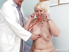 Bozena is a mature lady with big boobs, concupiscent face and big ass. After doctor asks her to strip this fellow is using a sucking machine to make her nipples harder. This doc has a messy mind and surely this fellow is making her horny, who knows what tricks this fellow has to make this old whore willing to fuck.