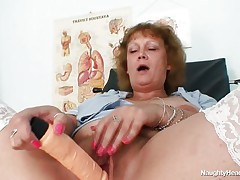 This old doxy is very horny and want to masturbate whilst sitting on gynecologist table. This chick is naked showing her large snatch and her large breasts. This chick take a thick sex-toy and start penetrating her pussy very deep and slow feeling how the large squirting orgasm is approaching.