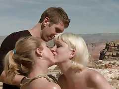 They are in the desert, the burning sun is upon 'em and made 'em insanely hawt so they fuck like crazy, one babe licks the other ones fur pie and gets drilled in the rectal hole with a dildo. The blonde that is receiving a tongue in her fur pie is tied and lays on the sand, will the guy cool her with some sperm?