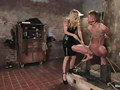 That babe got her guy tied nice-looking nice and now she's having some joy with his body, paying a lot of special attention to his cock. This sexy bossy milf with blonde hair and fit body is using her tools to taunt and induce pain to her man. Look at her thrashing his 10-Pounder and body as he's tied up and ball gagged.