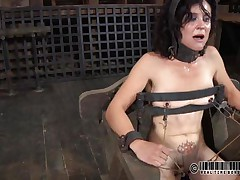 That chair is perfect for miss James. She's naked, thonged on it and a bit terrified with what's about to happen. The executor gapes her cunt using metal clamps and some kind of dildo is filling her womb. The ravishing brunette endures her torment and step by step she learns to like it!