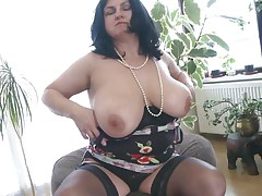 This overweight older is going insane and definitely in need of some masturbation. So with out wasting any time she is revealing her huge boobs and crushing them to make her pussy wet. After she is rubbing her pussy and fingering it. As soon as is becomes wet she is licking her love juice through her hands.
