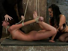 Take a look at these hot brunettes, one is bound up and the other one lubes her fingers and then waits until a guy ties the other hottie neck. After this babe is completely immobilized the chick fingers hard that fur pie during the time that this babe takes a hard cock in her mouth. She's getting fucked in her face hole and twat in the same time and the fact that she's bound up is only increasing her pleasure, what a slut!