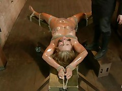 Blonde slut Cameron is all tied up with strings to a wooden table and face hole gagged. With her legs spread, that babe gets fingered and has a sex tool on her clitoris. Let`s take a close look at that hawt oiled up body and with wax all over her! Will her goddess make that wench cum if her cum-hole gets fisted so hard?