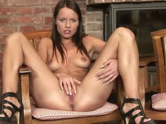 Kari rubs her shaved snatch by the fireplace